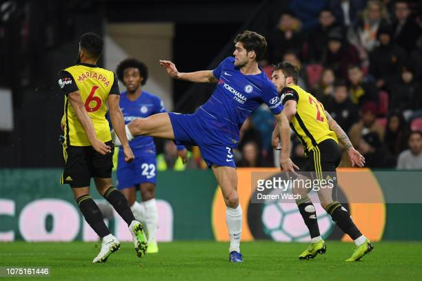 Marcos Alonso of Chelsea battles for possession with Adrian Mariappa of Watford during the Premier League match between Watford FC and Chelsea FC at...