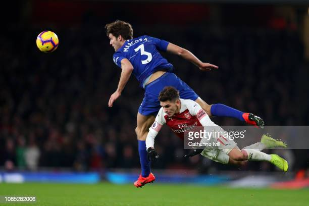 Marcos Alonso of Chelsea battles for possession with Lucas Torreira of Arsenal during the Premier League match between Arsenal FC and Chelsea FC at...