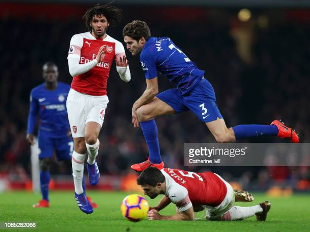 Marcos Alonso of Chelsea battles for possession with Sokratis Papastathopoulos and Mohamed Elneny of Arsenal during the Premier League match between...