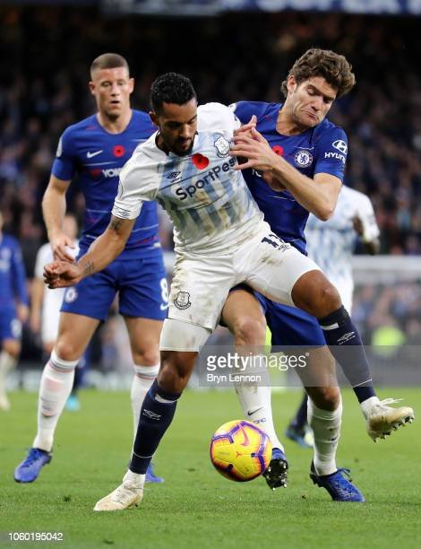 Marcos Alonso of Chelsea battles for possession with Theo Walcott of Everton during the Premier League match between Chelsea FC and Everton FC at...