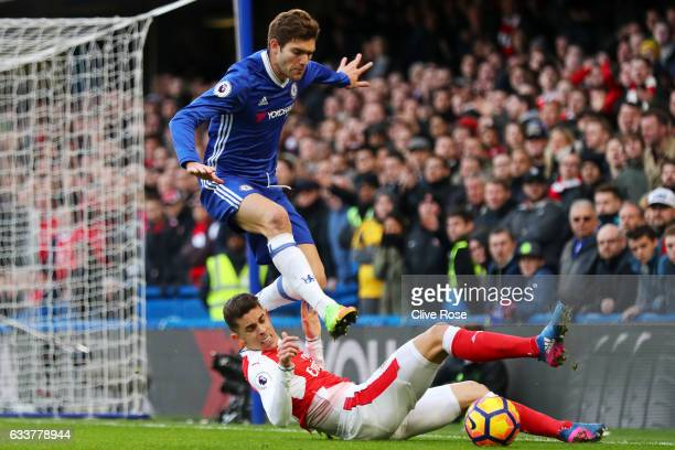 Marcos Alonso of Chelsea battles for the ball with Gabriel Paulista of Arsenal during the Premier League match between Chelsea and Arsenal at...