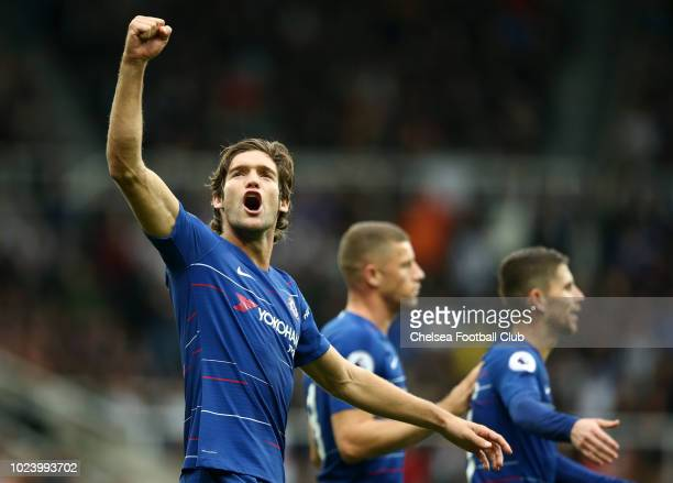 Marcos Alonso of Chelsea celebrates after his cross is deflected in by Deandre Yedlin of Newcastle United scoring Chelsea's second goal during the...