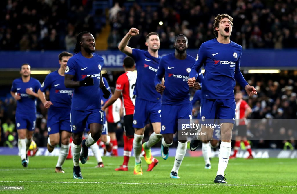 Marcos Alonso of Chelsea celebrates after scoring his sides first goal with his Chelsea team mates during the Premier League match between Chelsea and Southampton at Stamford Bridge on December 16, 2017 in London, England.