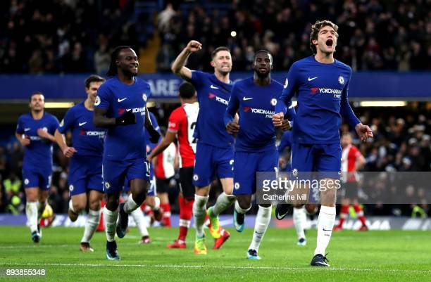 Marcos Alonso of Chelsea celebrates after scoring his sides first goal with his Chelsea team mates during the Premier League match between Chelsea...
