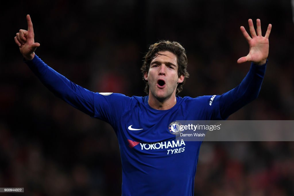 Marcos Alonso of Chelsea celebrates after scoring his sides second goal during the Premier League match between Arsenal and Chelsea at Emirates Stadium on January 3, 2018 in London, England.