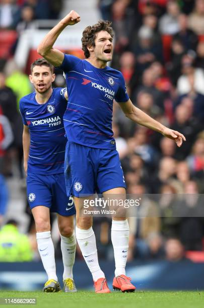 Marcos Alonso of Chelsea celebrates after scoring his team's first goal with Jorginho during the Premier League match between Manchester United and...