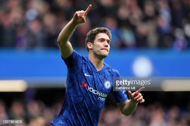 Marcos Alonso of Chelsea celebrates after scoring his teams second goal during the Premier League match between Chelsea FC and Tottenham Hotspur at...