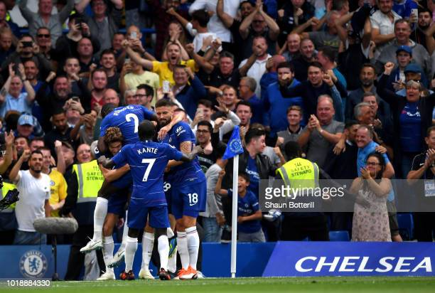 Marcos Alonso of Chelsea celebrates after scoring his team's third goal with team mates during the Premier League match between Chelsea FC and...