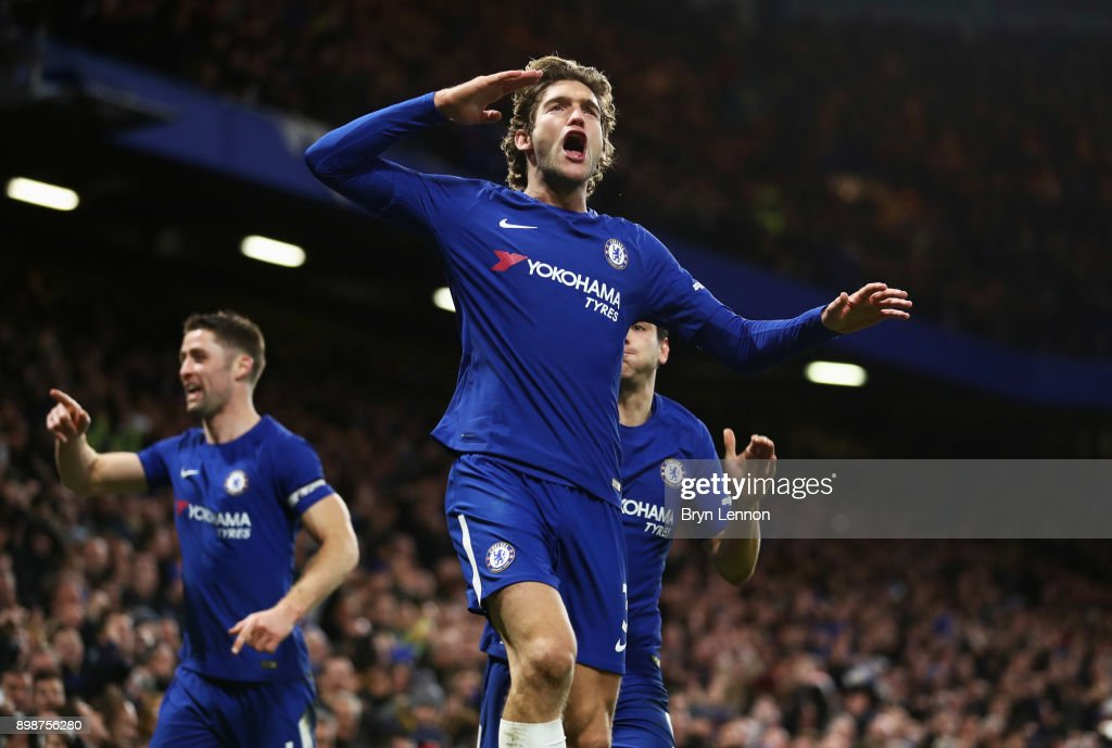 Marcos Alonso of Chelsea celebrates as he scores their second goal during the Premier League match between Chelsea and Brighton and Hove Albion at Stamford Bridge on December 26, 2017 in London, England.