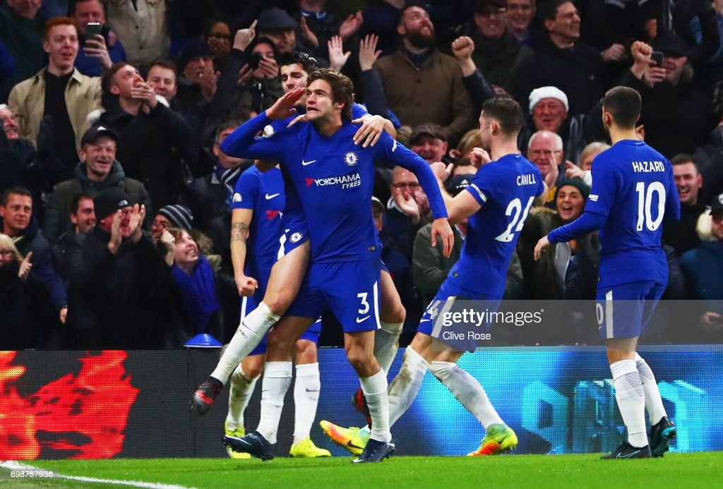 Marcos Alonso of Chelsea (3) celebrates as he scores their second goal with team mates during the Premier League match between Chelsea and Brighton and Hove Albion at Stamford Bridge on December 26, 2017 in London, England.