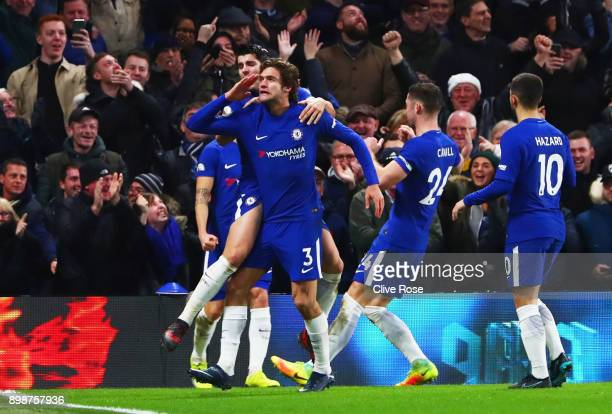 Marcos Alonso of Chelsea celebrates as he scores their second goal with team mates during the Premier League match between Chelsea and Brighton and...