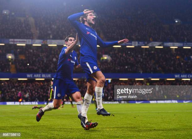 Marcos Alonso of Chelsea celebrates as he scores their second goal with Alvaro Morata during the Premier League match between Chelsea and Brighton...