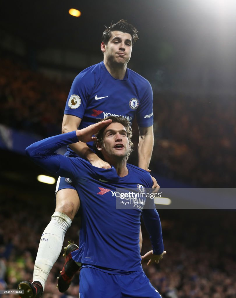 Marcos Alonso of Chelsea celebrates as he scores their second goal with Alvaro Morata during the Premier League match between Chelsea and Brighton and Hove Albion at Stamford Bridge on December 26, 2017 in London, England.