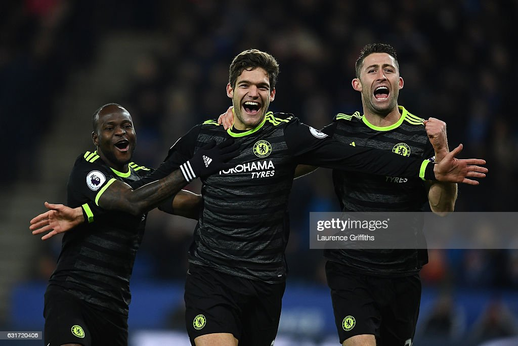 Marcos Alonso of Chelsea celebrates his second goal alongside Victor Moses (L) and Gary Cahill (R) during the Premier League match between Leicester City and Chelsea at The King Power Stadium on January 14, 2017 in Leicester, England.