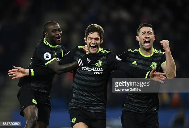 Marcos Alonso of Chelsea celebrates his second goal alongside Victor Moses and Gary Cahill during the Premier League match between Leicester City and...