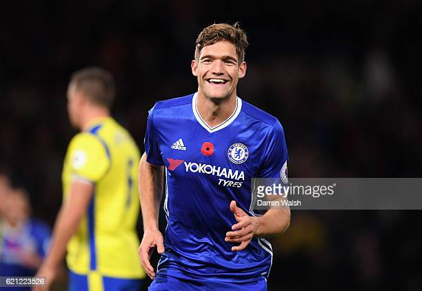 Marcos Alonso of Chelsea celebrates scoring his sides second goal during the Premier League match between Chelsea and Everton at Stamford Bridge on...