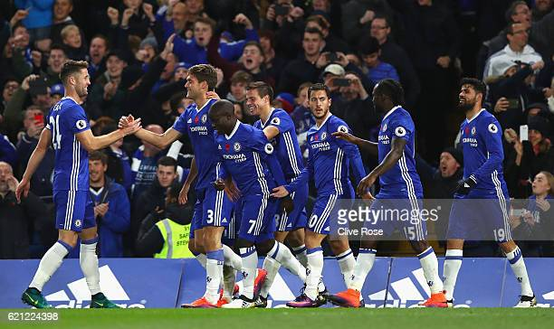 Marcos Alonso of Chelsea celebrates scoring his sides second goal with his Chelsea team mates during the Premier League match between Chelsea and...