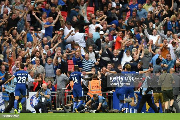Marcos Alonso of Chelsea celebrates scoring his sides second goal with the Chelsea fans during the Premier League match between Tottenham Hotspur and...
