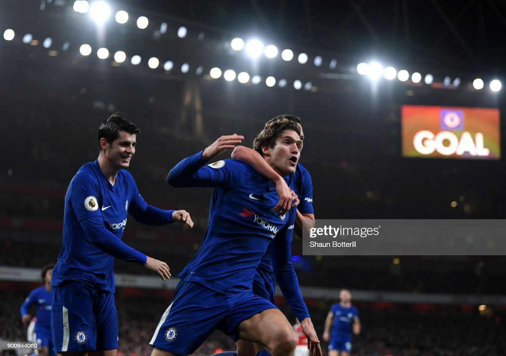 Marcos Alonso of Chelsea celebrates scoring his sides second goal with Danny Drinkwater of Chelsea (obscured) during the Premier League match between Arsenal and Chelsea at Emirates Stadium on January 3, 2018 in London, England.