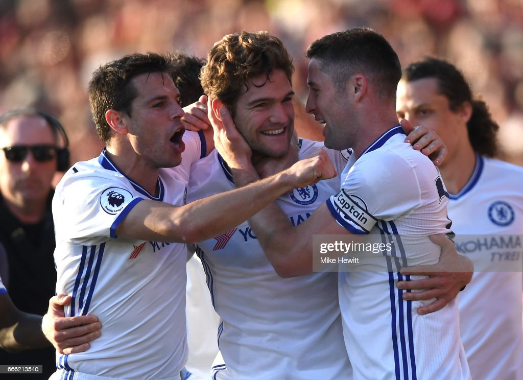 Marcos Alonso of Chelsea celebrates scoring his sides third goal with his Chelsea team mates during the Premier League match between AFC Bournemouth and Chelsea at Vitality Stadium on April 8, 2017 in Bournemouth, England.