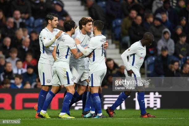 Marcos Alonso of Chelsea celebrates scoring his side's third goal with his team mates during the Premier League match between West Bromwich Albion...