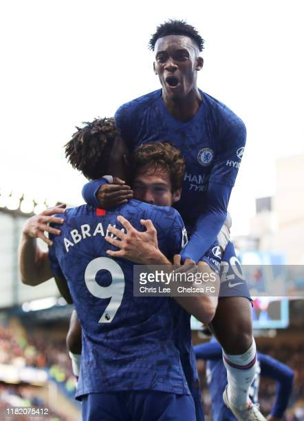 Marcos Alonso of Chelsea celebrates scoring his team's first goal with teammate Tammy Abraham as Callum HudsonOdoi jumps on top during the Premier...