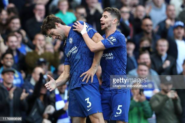 Marcos Alonso of Chelsea celebrates scoring the only goal of the match with Jorginho during the Premier League match between Chelsea FC and Newcastle...