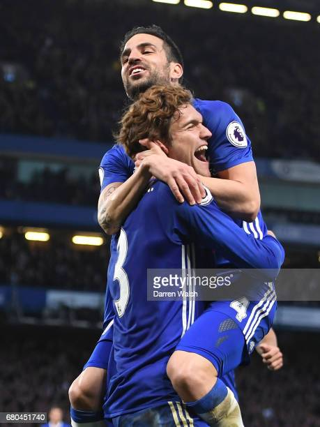 Marcos Alonso of Chelsea celebrates with Cesc Fabregas after scoring his sides second goal during the Premier League match between Chelsea and...