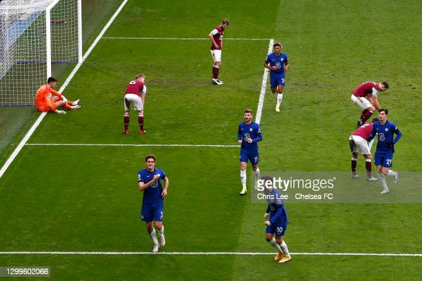 Marcos Alonso of Chelsea celebrates with team mate Christian Pulisic after scoring their side's second goal as Nick Pope and Erik Pieters of Burnley...