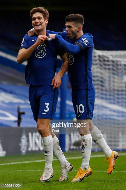 Marcos Alonso of Chelsea celebrates with team mate Christian Pulisic after scoring their side's second goal during the Premier League match between...