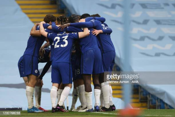 Marcos Alonso of Chelsea celebrates with team mates after scoring a goal to make it 1-2 during the Premier League match between Manchester City and...