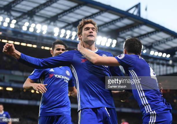 Marcos Alonso of Chelsea celebrates with team mates after scoring his side second goal during the Premier League match between Chelsea and...