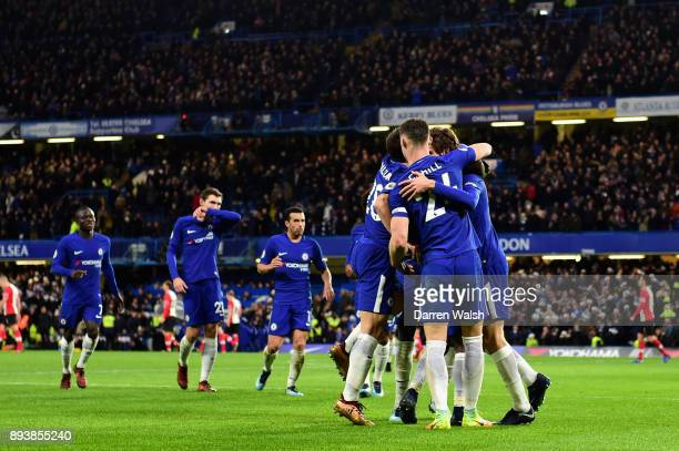 Marcos Alonso of Chelsea celebrates with team mates after scoring his sides first goal during the Premier League match between Chelsea and...