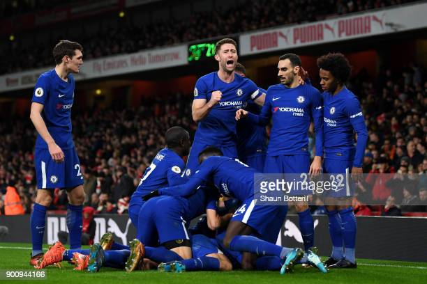 Marcos Alonso of Chelsea celebrates with team mates after scoring his sides second goal during the Premier League match between Arsenal and Chelsea...