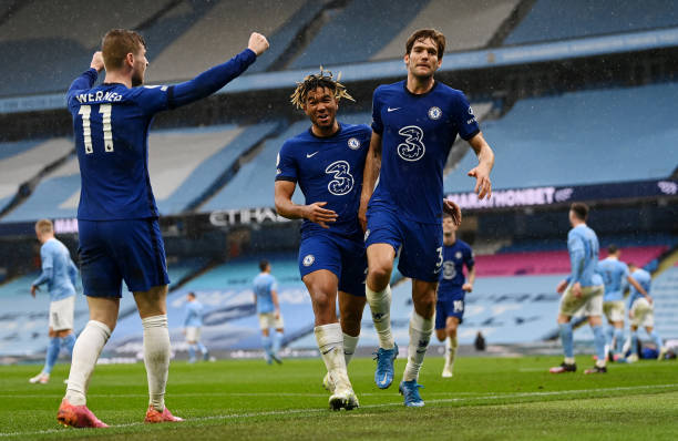 Marcos Alonso of Chelsea celebrates with team mates Reece James and Timo Werner after scoring their side's second goal during the Premier League...