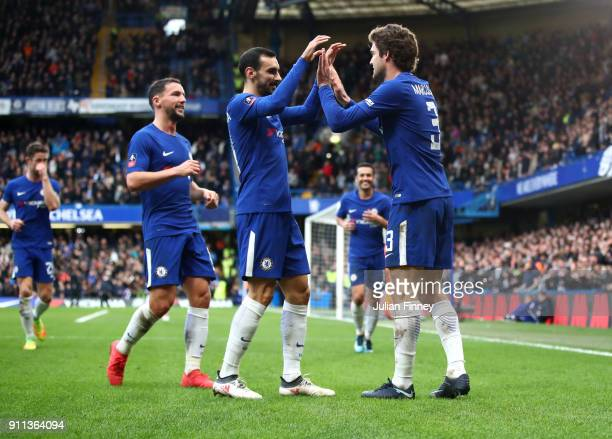Marcos Alonso of Chelsea celebrates with teammate Davide Zappacosta after scoring his sides third goal during The Emirates FA Cup Fourth Round match...