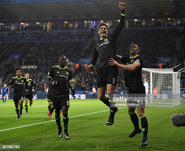 Marcos Alonso of Chelsea celebrates with teammate Gary Cahill after scoring his team's second goal during the Premier League match between Leicester...