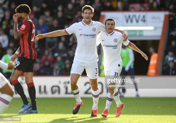 Marcos Alonso of Chelsea celebrates with teammate Pedro after scoring his sides first goal during the Premier League match between AFC Bournemouth...