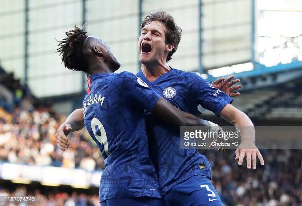 Marcos Alonso of Chelsea celebrates with teammate Tammy Abraham after scoring his team's first goal during the Premier League match between Chelsea...