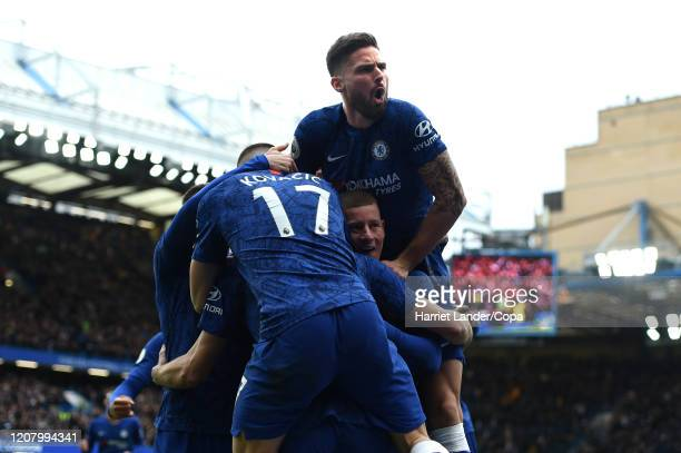 Marcos Alonso of Chelsea celebrates with teammates after scoring his team's second goal during the Premier League match between Chelsea FC and...