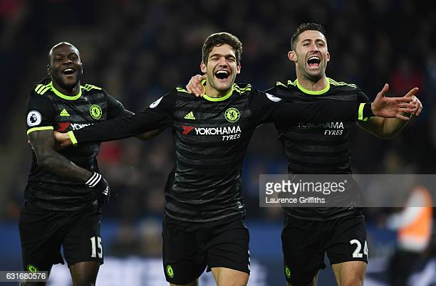 Marcos Alonso of Chelsea celebrates with teammates after scoring his team's second goal during the Premier League match between Leicester City and...