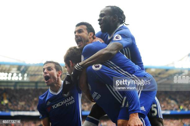 Marcos Alonso of Chelsea celebrates with teammates after scoring the opening goal during the Premier League match between Chelsea and Arsenal at...