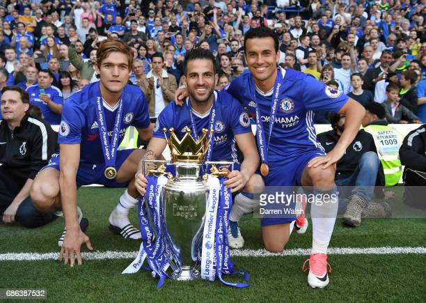 Marcos Alonso of Chelsea Cesc Fabregas of Chelsea and Pedro of Chelsea pose with the Premier League Trophy after the Premier League match between...
