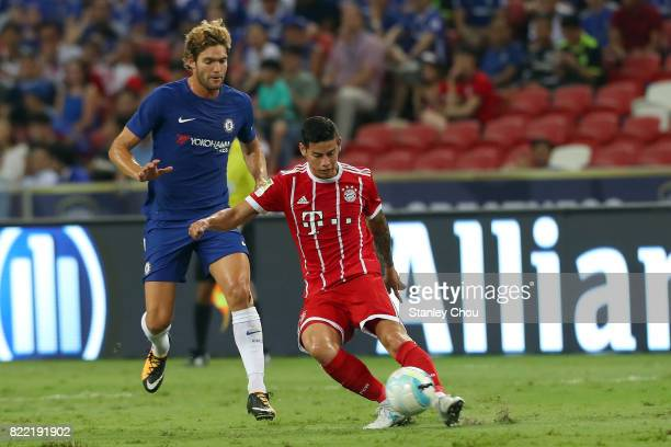 Marcos Alonso of Chelsea checks James Rodriguez of Bayern Munich during the International Champions Cup match between Chelsea FC and FC Bayern Munich...
