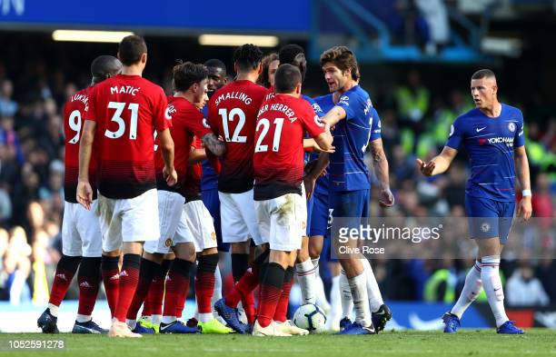Marcos Alonso of Chelsea clashes with the Manchester United team during the Premier League match between Chelsea FC and Manchester United at Stamford...