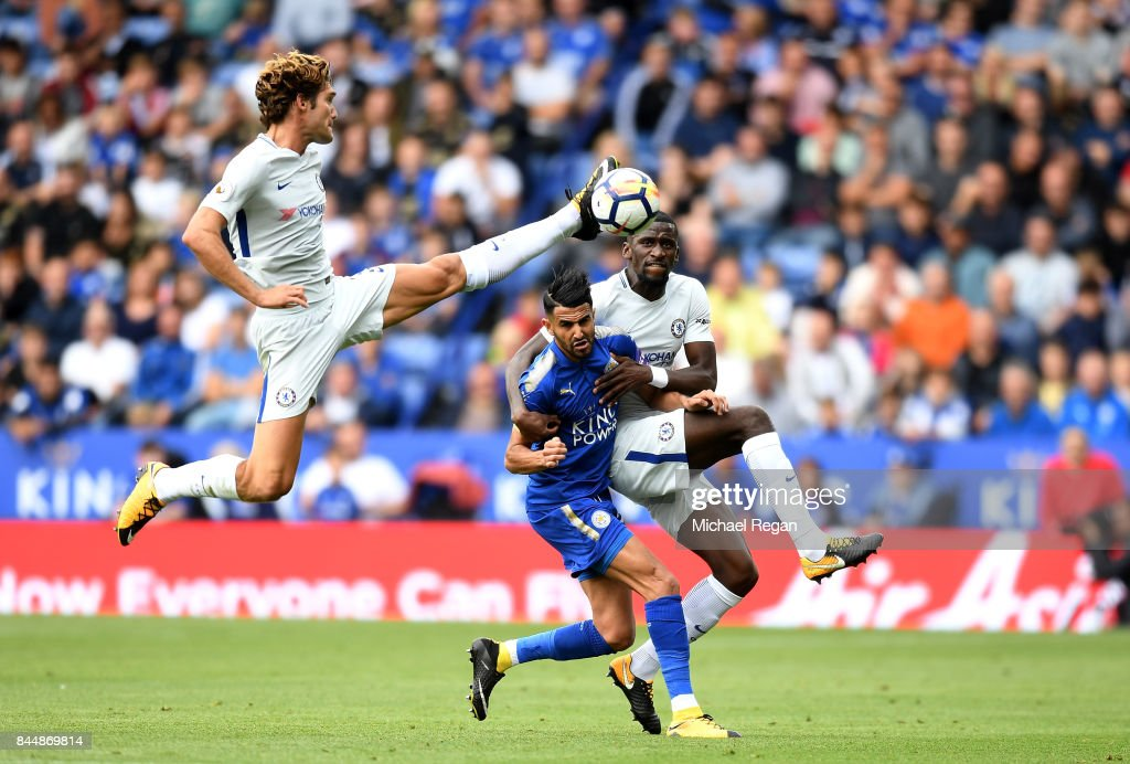 Marcos Alonso of Chelsea controls the ball as Riyad Mahrez of Leicester City and Antonio Rudiger of Chelsea battle for possession during the Premier League match between Leicester City and Chelsea at The King Power Stadium on September 9, 2017 in Leicester, England.
