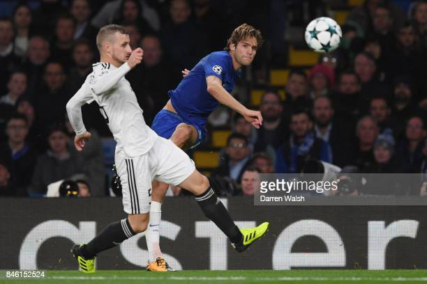Marcos Alonso of Chelsea crosses the ball during the UEFA Champions League Group C match between Chelsea FC and Qarabag FK at Stamford Bridge on...