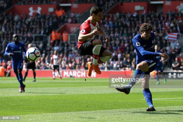 Marcos Alonso of Chelsea crosses the ball past Cedric Soares of Southampton during the Premier League match between Southampton and Chelsea at St...