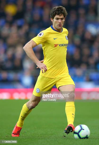 Marcos Alonso of Chelsea FC runs with the ball during the Premier League match between Everton FC and Chelsea FC at Goodison Park on March 17 2019 in...