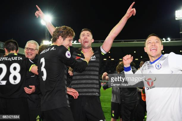 Marcos Alonso of Chelsea Gary Cahill of Chelsea and John Terry of Chelsea celebrate winning the leauge after the Premier League match between West...